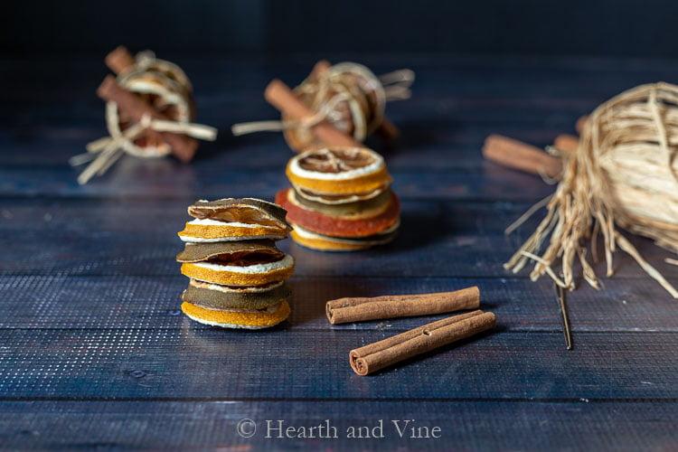 Stacks of dried fruit, cinnamon sticks and  raffia.