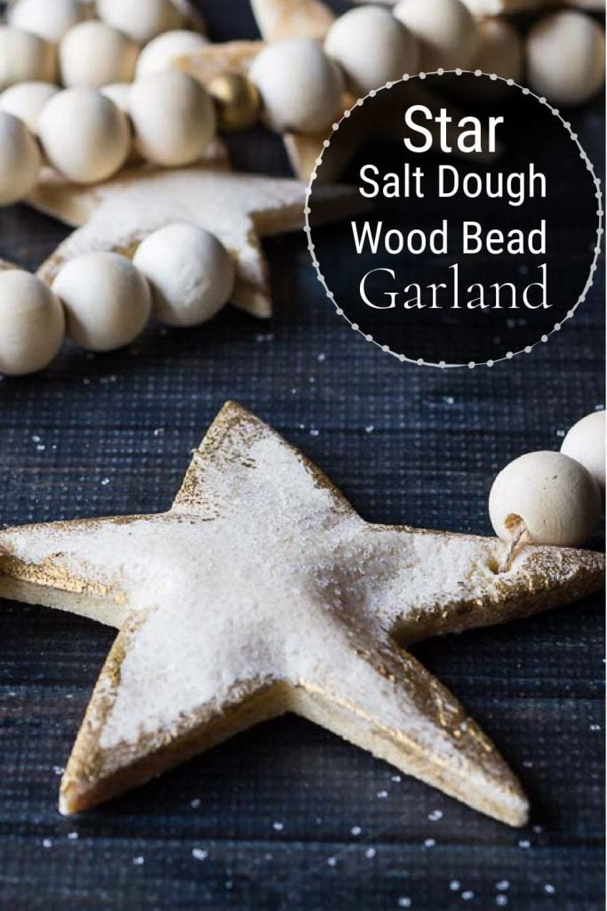 Large salt dough start strung on string with wood beads to use as a garland.