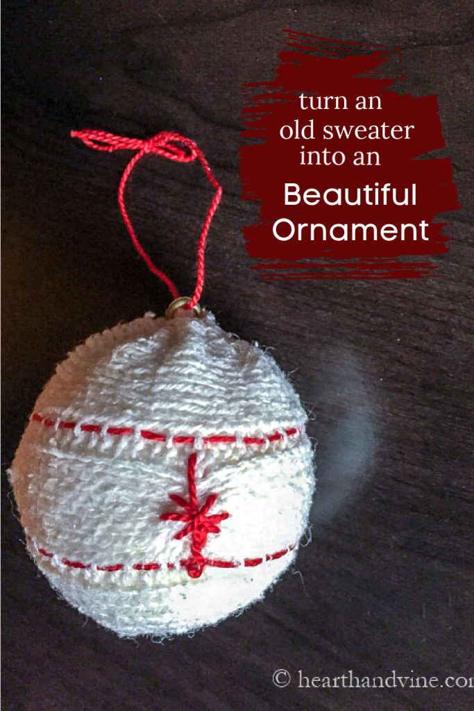 White cable sweater embroidered ornament with red thread.