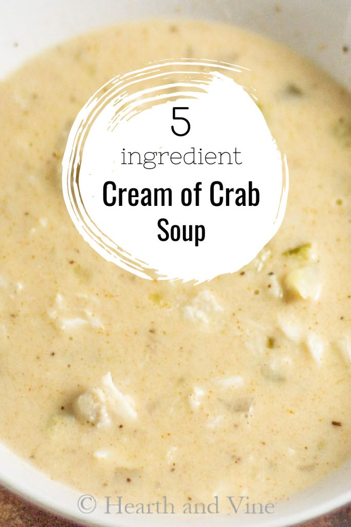 White bowl with cream of crab soup and a text overlay stating 5 ingredient cream of crab soup.