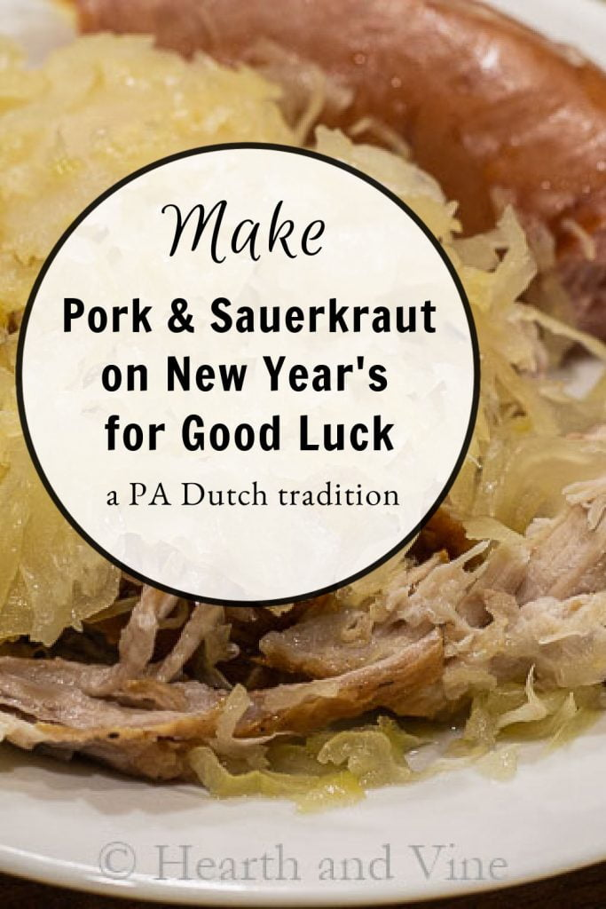 Pork, sauerkraut and kielbasa on a plate.