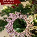 Red and white striped rag wreath ornament on tree
