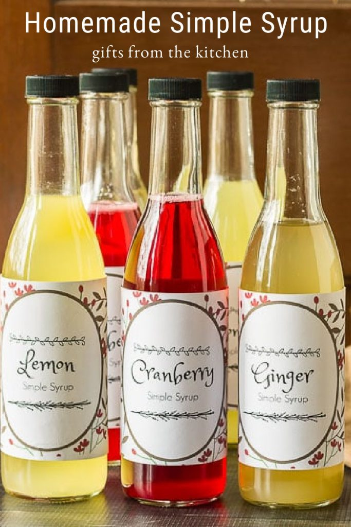 Lemon, cranberrry and ginger simple syrup bottles with labels.