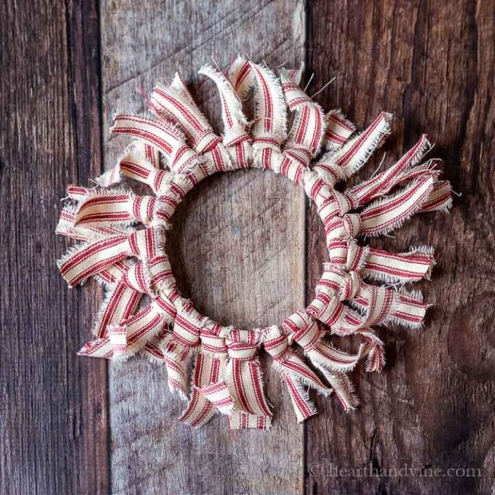 Red and white striped rag wreath ornament.