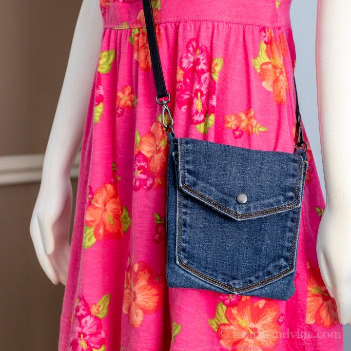Blue jean mini bag on mannequin.