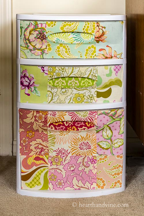 3 drawer plastic set with fabric covered fronts.