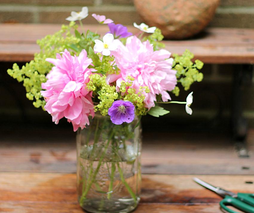 Flower bouquet in a small jar