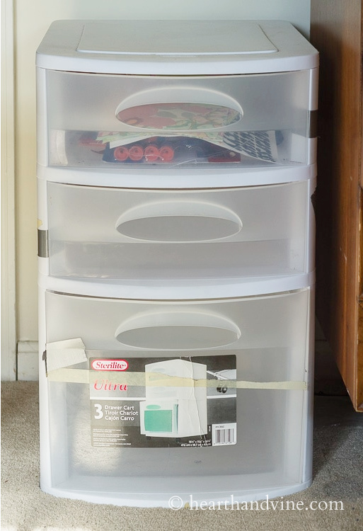 Basic three drawer plastic container.