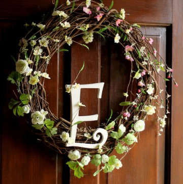 Spring grapevine wreath with large letter E.