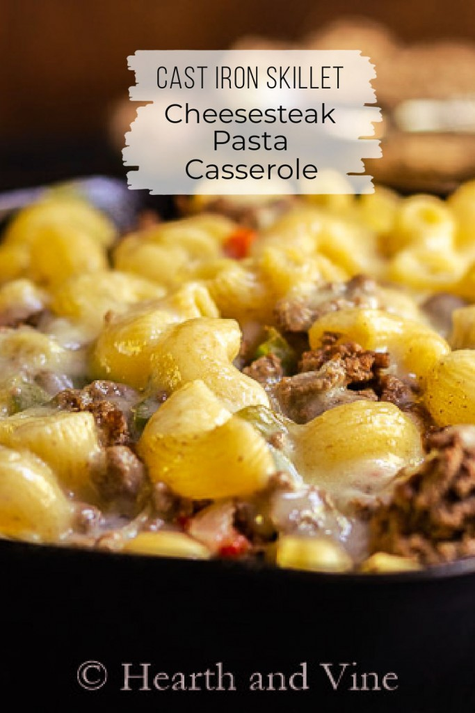 Close up of Philly cheesesteak pasta dish in a cast iron skillet