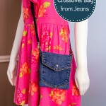 Mannequin with pink dress and denim crossbody bag.
