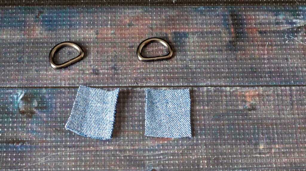 Two D-rings and 2 inch squares of denim fabric.