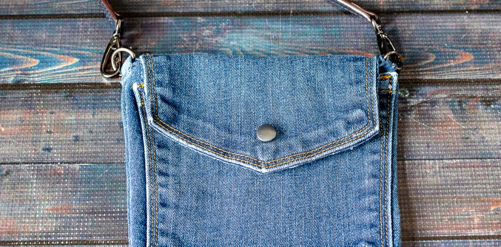 Blue jean bag with snap.