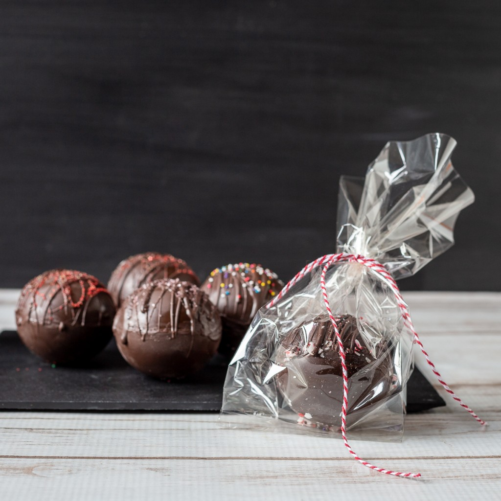 Homemade hot chocolate bombs and one in a bag.