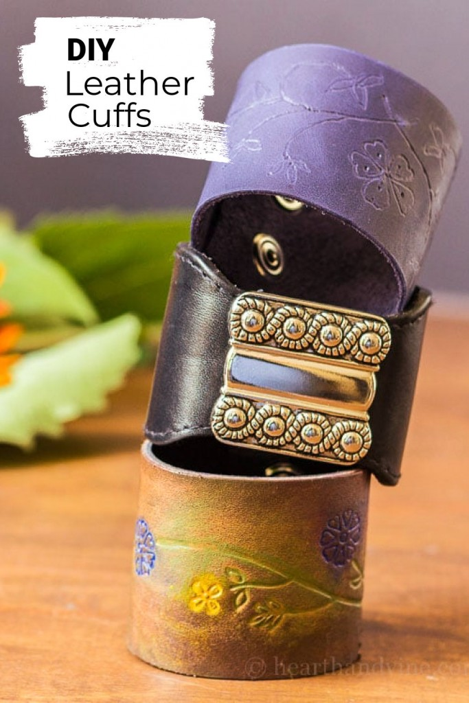 Stack of leather wrist cuffs easily made from thrift store belts and a piece of leather with snaps.