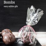 Tray of hot chocolate bombs and one in a wrapped plastic bag.