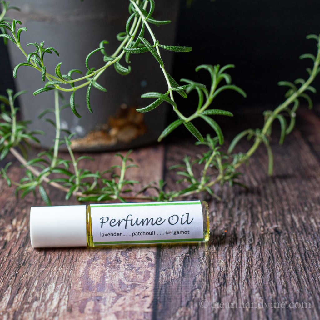 Perfume oil bottle on it's side with a label that says Perfume Oil lavender... patchouli... bergamot