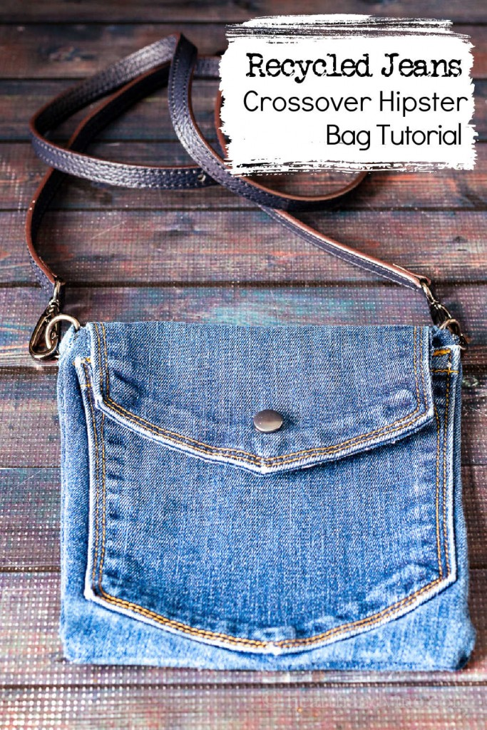Blue jean handmade crossbody bag with leather strap and snap opening.