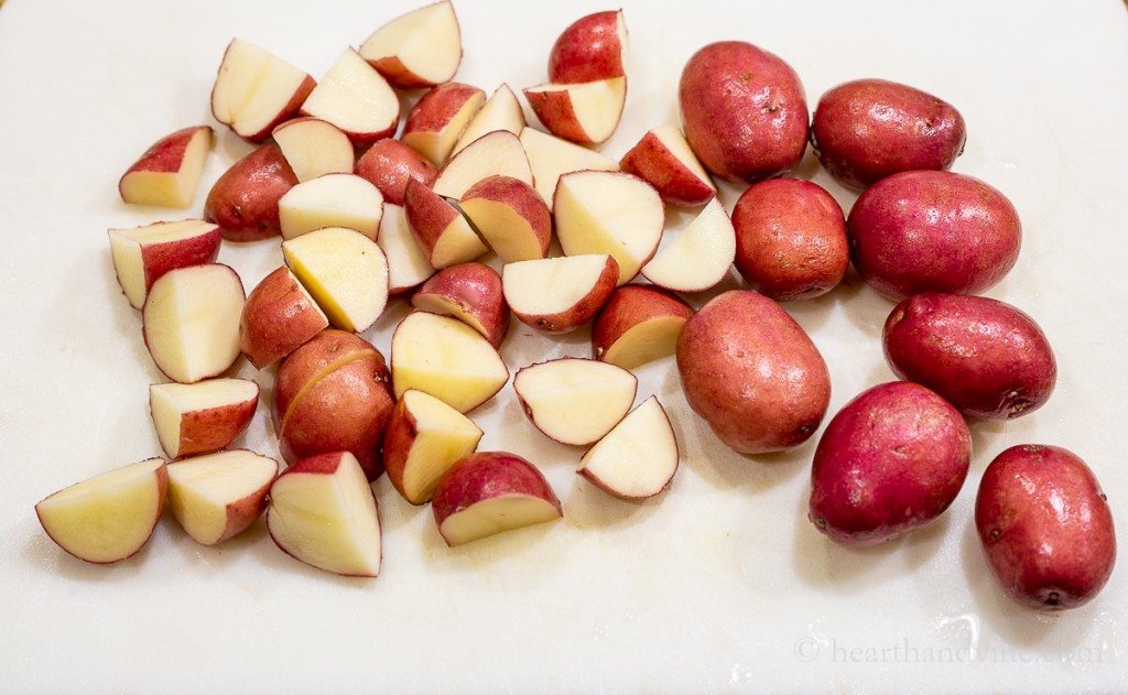 Red skinned potatoes cut up.