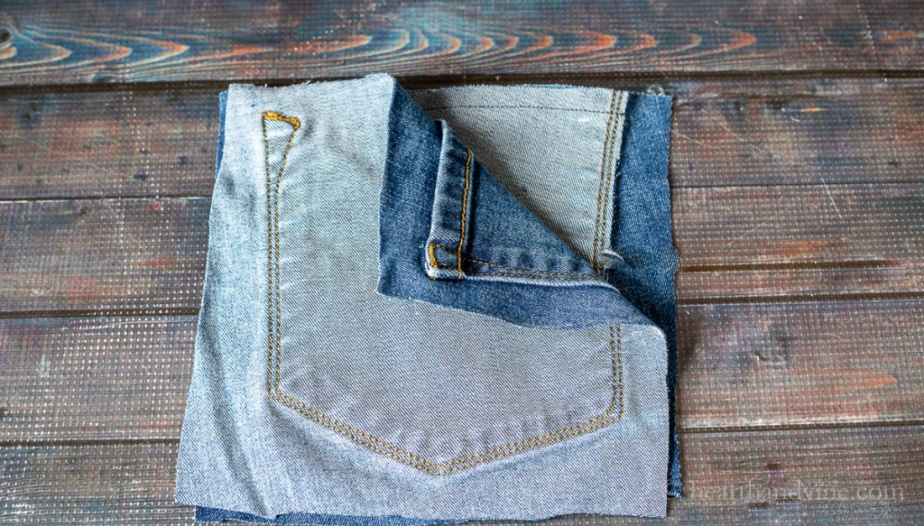 Two pocket pieces sewn together to make jean bag.