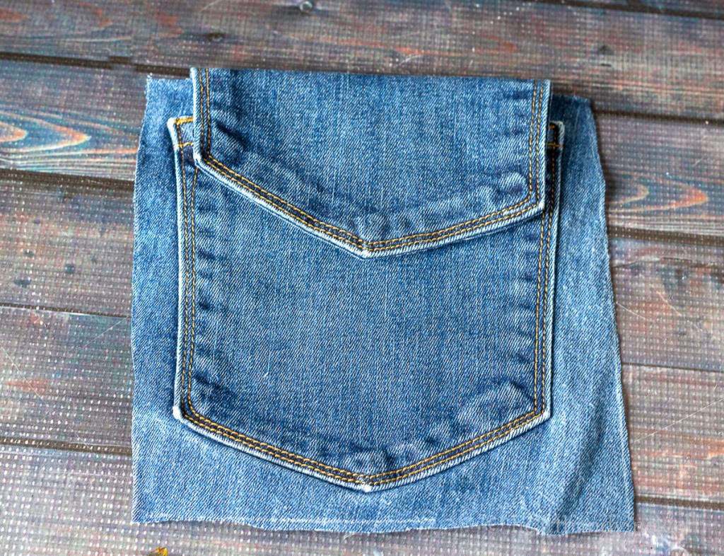 Jean pocket draped over another jean pocket.