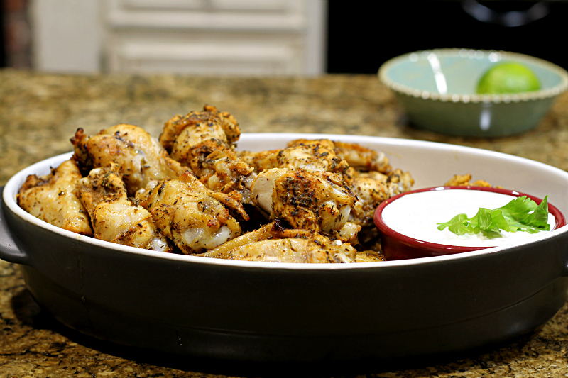 Baked chicken wings with blue cheese dressing.
