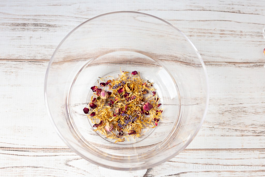 Large clear bowl with rose petals, calendula petals and lavender buds.