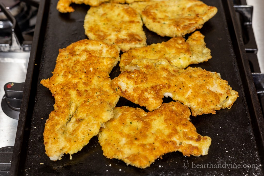 Breaded chicken breasts fried in olive oil until golden brown.