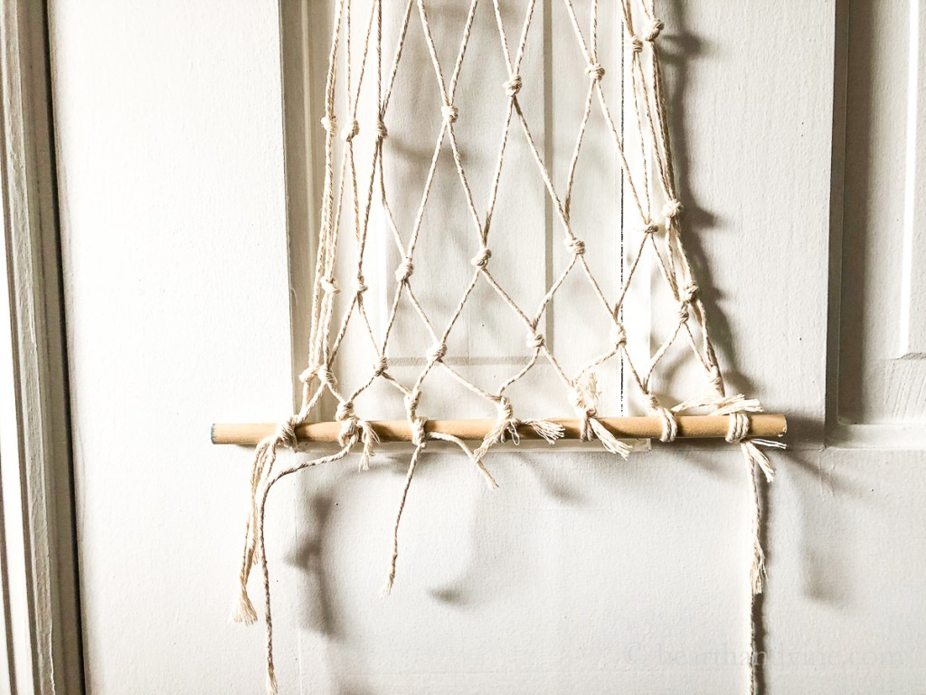 Macrame hammock bottom knots and straggling twine.
