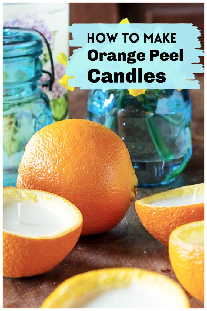 Empty half orange rinds made into candles.