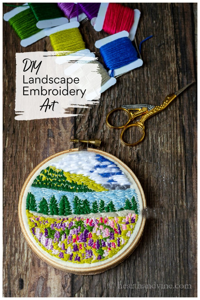 4 inch hoop with an embroidered landscape and a mini pair of scissors.
