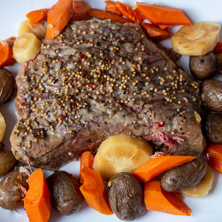 Roast corned beef with potatoes, carrots and parsnips