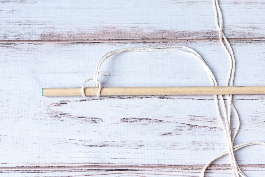 Cotton twine tied on to a dowel rod