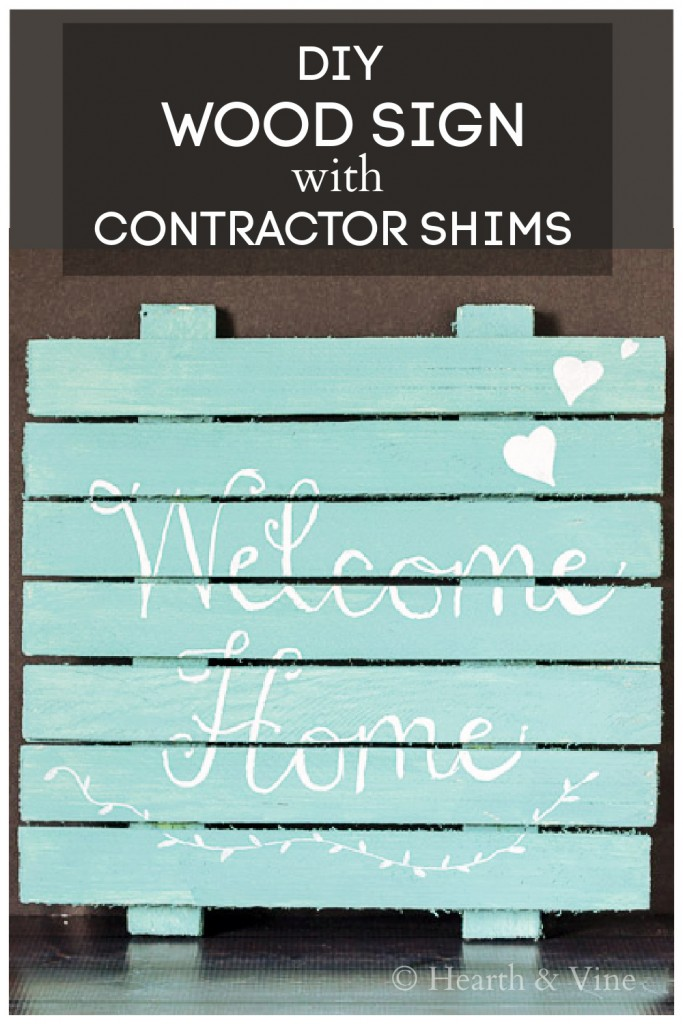 Aqua and white welcome home sign made from wood shims