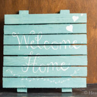 Wood shim welcome sign in aqua and white