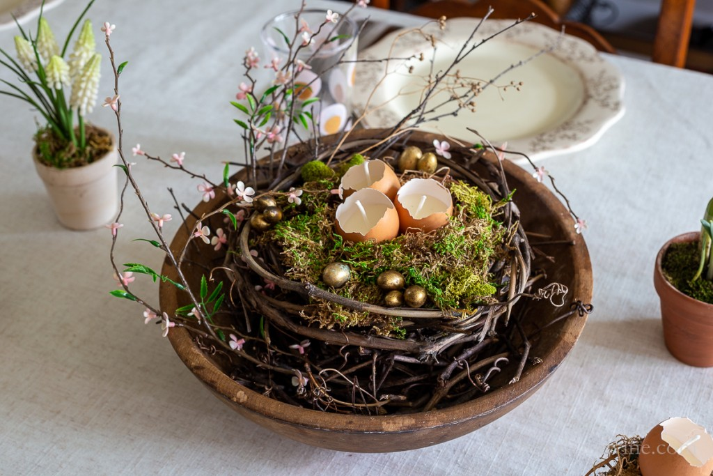 View of Easter centerpiece on table next to faux white grape hyacinth pot and daffodil pot.