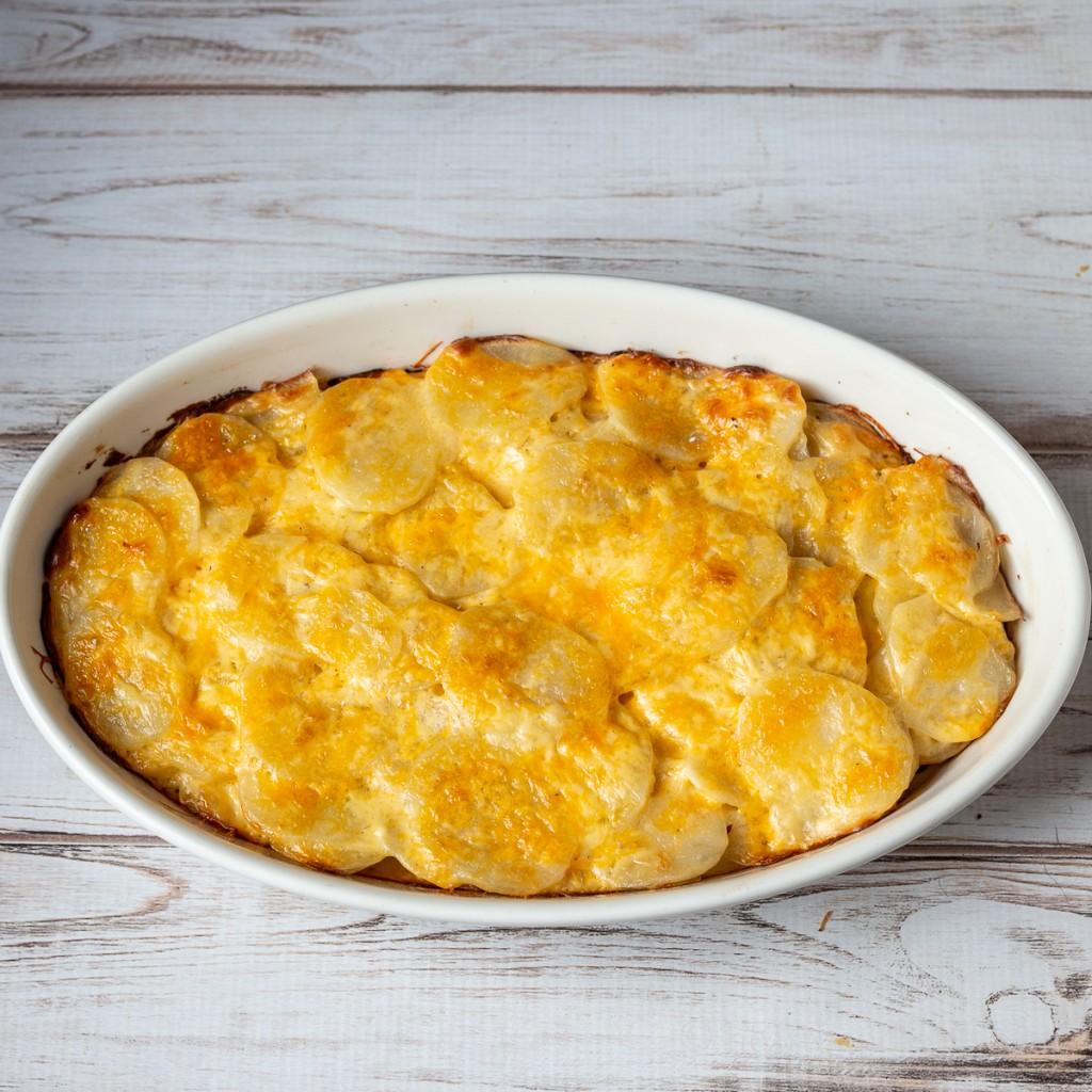 Baking pan of potatoes au gratin.