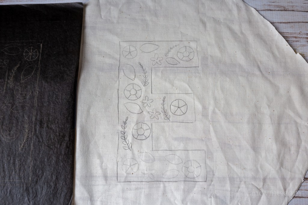 Letter E pattern inside traced onto muslin.