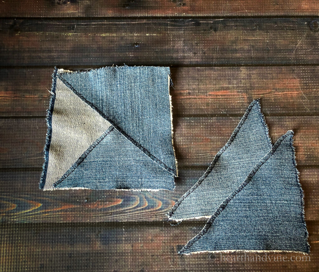 Two denim triangles over-lapped on a denim square. Two additional triangles on the right.