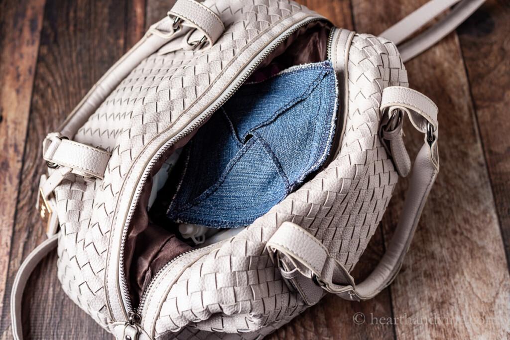 Handmade denim pouch inside a handbag.