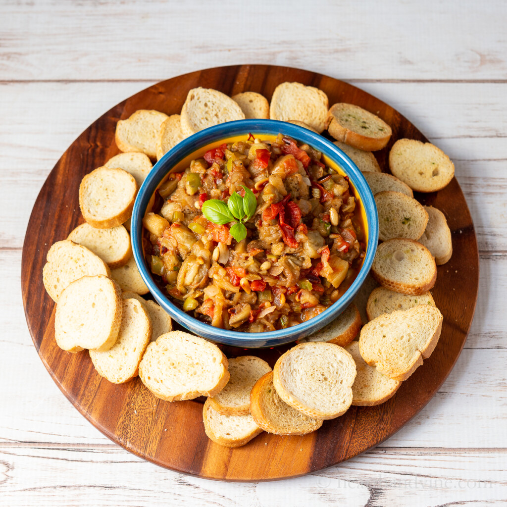 Roasted eggplant caponata surrounded by bread rounds