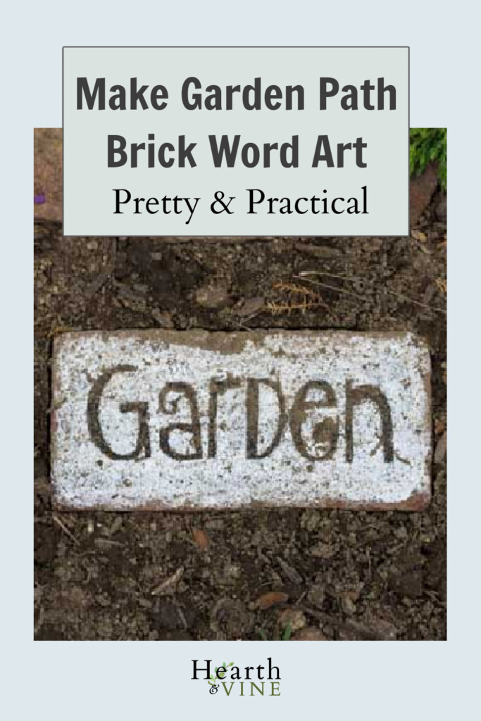 Brick in garden path with white paint and the word Garden painted in black.