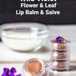 Violet flowers, small containers of violet infused lip balm.