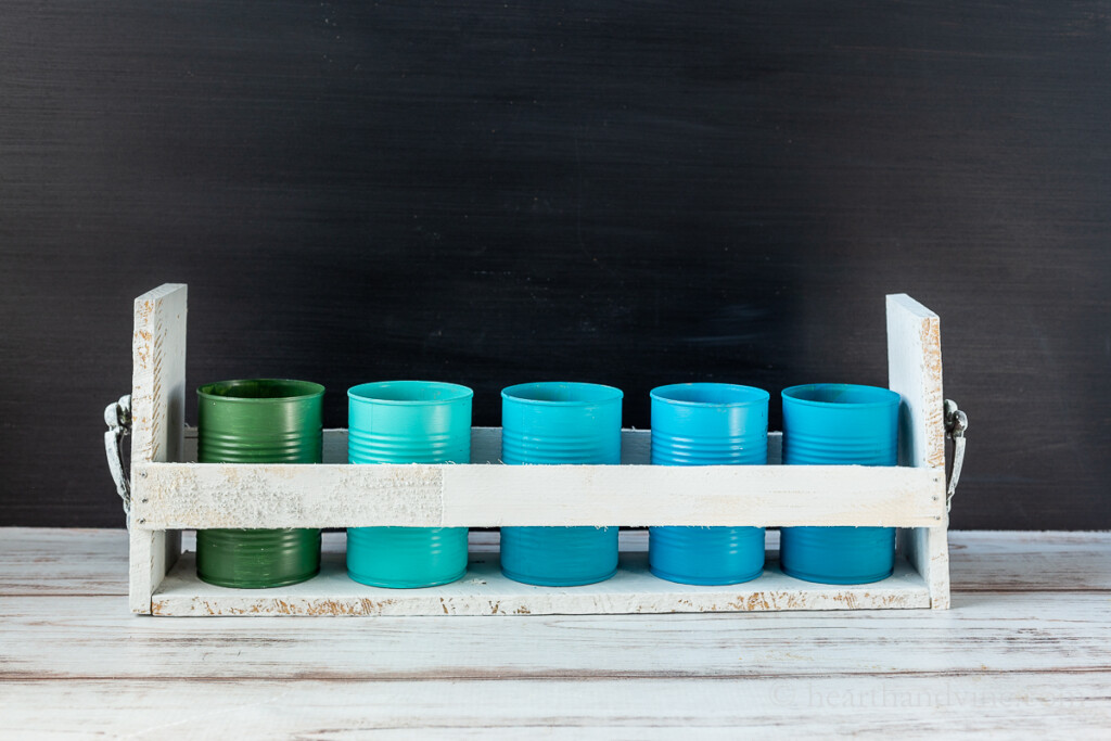 Tin can upcycle organizer with pallet wood and shims.