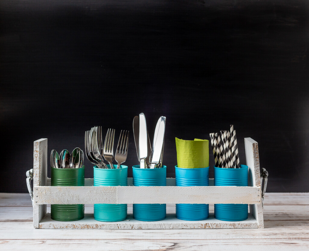 Utensils, straws and napkins in tin can upcycled DIY caddy.