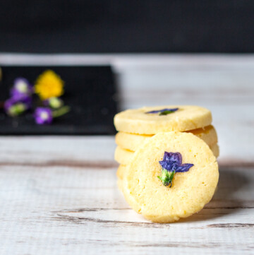 Cookies with violet flower on top.