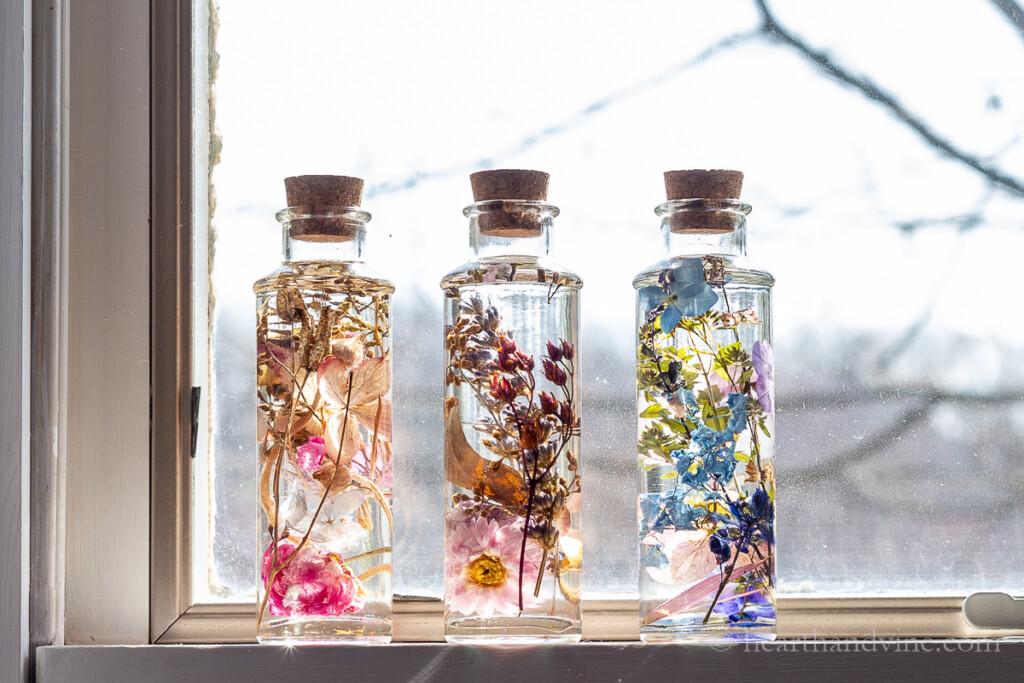 Three Japanese Herbarium bottles on a windowsill.
