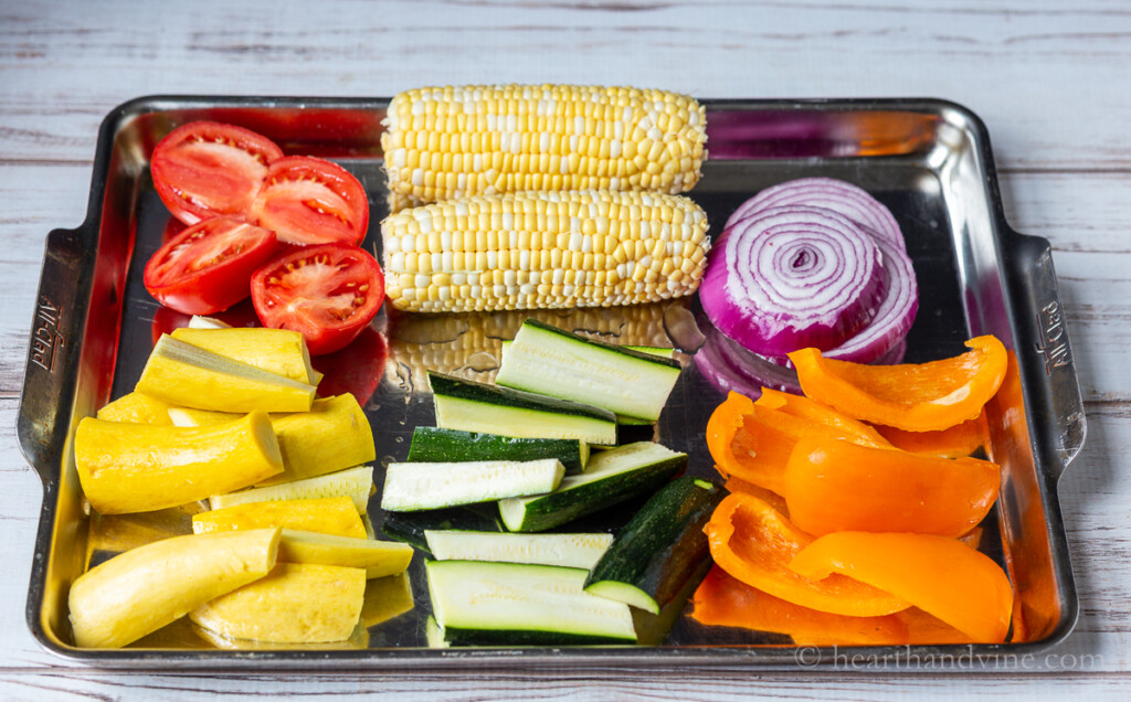 Vegetables on a large jelly roll pan.
