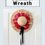 Bright pink florals on straw hat wreath for white door.