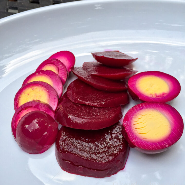 Sliced red pickled beet eggs and beets